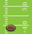 american football ball and field background vector image vector image