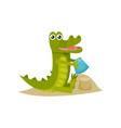 cute baby crocodile building sand castle at the vector image vector image
