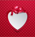 paper heart with ribbon on red background vector image