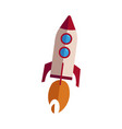 rocket taking off with fire vector image vector image