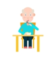 Elderly man eat at the table vector image vector image