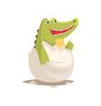 funny newborn crocodile in broken egg shell vector image vector image
