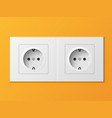 white double power socket on orange wall vector image