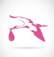 stork carrying a bain its beak vector image
