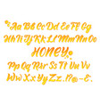 liquid honeyed latin alphabet with gold splashes vector image vector image