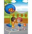 Two boys playing basketball at the basketball vector image