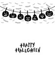 halloween pumpkins hanging on a clothespin rope vector image