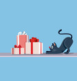 cat looking at christmas presents banner vector image vector image