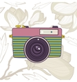 Elegant vintage camera on floral background vector image vector image