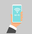 free wifi sign concept hand holding mobile phone vector image vector image