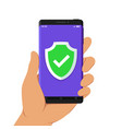 hand holding smartphone with green shield vector image vector image
