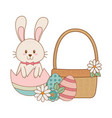 little rabbit with egg painted easter in basket vector image