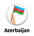 azerbaijan flag in hand round icon vector image
