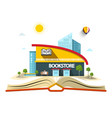 bookstore building on open book vector image vector image