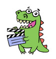 cute smiling dinosaur with movie clapper board vector image