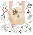 human hands decorating gift box or parcel wrapped vector image vector image