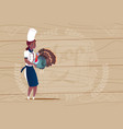 female african american chef cook holding turkey vector image vector image
