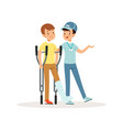 cheerful volunteer helping boy with crutches leg vector image vector image