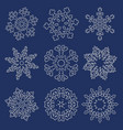 set of white linear snowflakes vector image