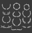 Hand drawn laurels wreaths doodle set