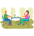 young man and woman are sitting in outdoor cafe vector image vector image