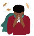 a cold man blows his nose in a handkerchief vector image vector image