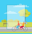 couple riding double bicycle in summertime park vector image vector image