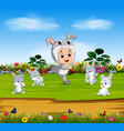 cute boy wearing the rabbit costume vector image vector image
