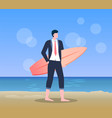 male holding surfboard standing on beach vector image vector image