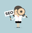 businesswoman looking magnify glass with seo sign vector image vector image