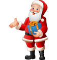 cartoon santa claus holding a gift box vector image