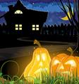 Pumpkins near a haunted house vector image vector image