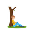 boy listening to music near tree in the park vector image vector image
