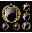 set of golden emblem with shield and wreaths vector image vector image