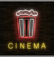 cinema light neon sign on brick background vector image vector image
