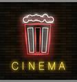 cinema light neon sign on brick background vector image