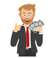 happy business man pointing to fan of dollar bills vector image vector image