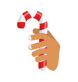 hand and candy cane arm holding christmas vector image vector image