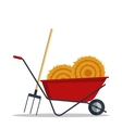 Red flat gardening wheelbarrow with hay and vector image vector image