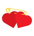 two red hearts fasten together by a safety pin vector image