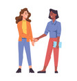 smiling multiracial female characters hand shaking vector image vector image