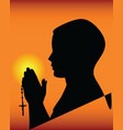 black silhouette of a praying vector image vector image