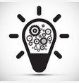 bulb with cogs - gears icon vector image