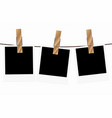 three blank instant photo frames on a rope vector image vector image