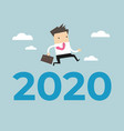 businessman jump over number 2020 vector image vector image