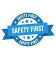 safety first ribbon safety first round blue sign vector image vector image