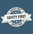 safety first ribbon safety first round white sign vector image vector image