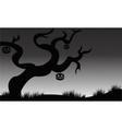 Halloween dry tree and pumkins vector image