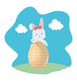 cute rabbit with easter egg painted in the camp vector image vector image