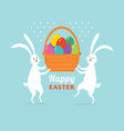 easter scene bunnies and big basket with eggs vector image vector image